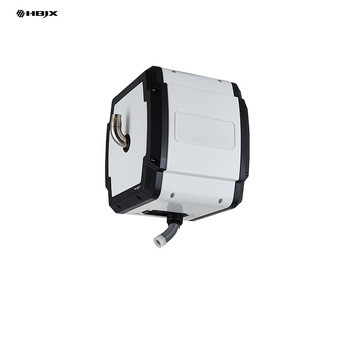 Retractable vacuum reel for washer shop cleaning